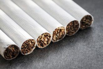 Cigarettes on dark background. Selective focus.