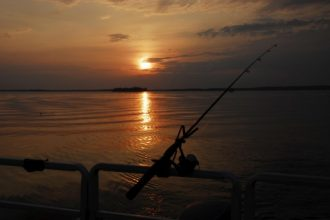 Lonley fishing pole cast into fishless waters on Big Manistique Lake in Curtis Michigan in Michigans Upper Peninsula