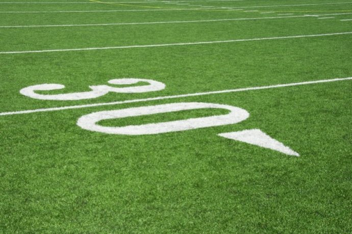 American Football field-close-up of the Thirty Yard line with Hash Marks