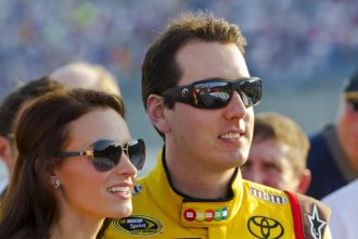 SPARTA, KY - JULY 09:  Kyle Busch (18) and Samantha Busch stand for the National Anthem before the Quaker State 400 race at the Kentucky Speedway in Sparta, KY on July 09, 2011.