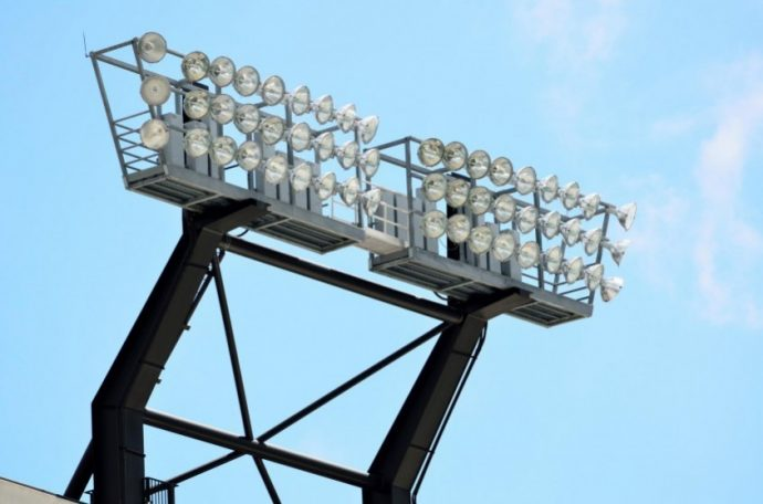 'Stadium lights at a college football field Georgia, USA.'