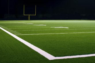 10, 20, & 30 Yard Line on American Football Field with Football Goal Post in distant.
