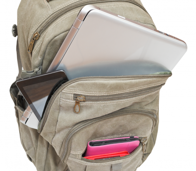 travel knapsack with mobile devices isolated on white background